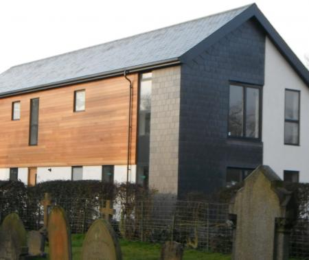 Finished property showing slate cladding to side & rear elevation