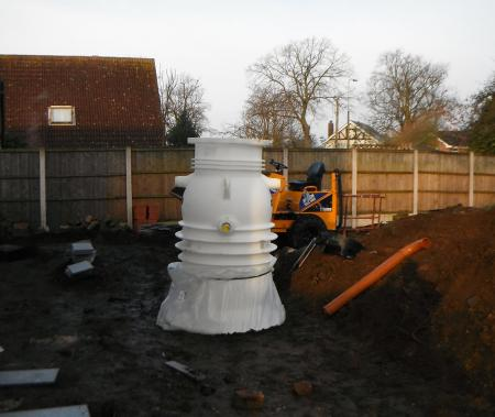 installation of mini pumping station to allow drains to be lowered enabling the house to sit lower on the plot