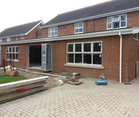 Rear extension with windows and doors installed