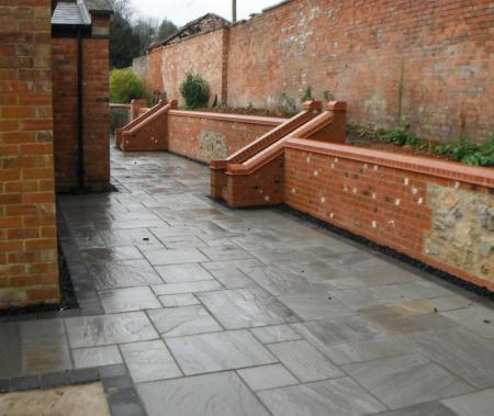newly paved patio with steps providing easy access to rebuilt raised beds