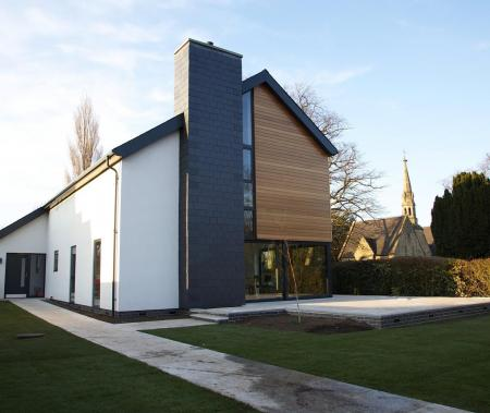Finished property showing slate clad feature chimney stack