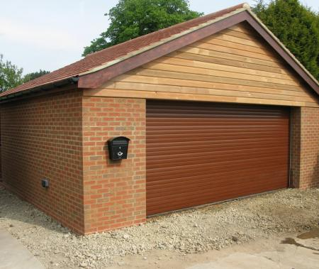 Double garage with oiled cedar wood cladding in Brigg